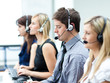 Attractive young man working in a call center - 15687253