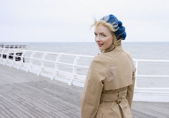 A woman on a boardwalk at the beach