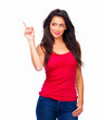 Smiling young lady in red top standing against isolated white