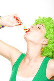 attractive woman with green wig sucking on a lolly pop poster