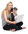 Young woman sitting with pet dog and laptop, portrait