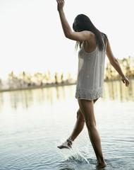 A woman kicking up water