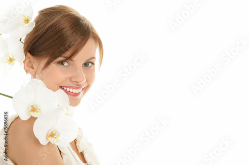 Portrait of young beauty woman with orchid