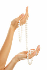 Hands with pearl necklace