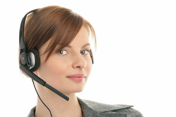Friendly secretary/telephone operator wearing headset