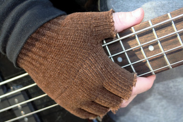 Gloved Hand on Frets