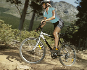 A woman biking on a trail
