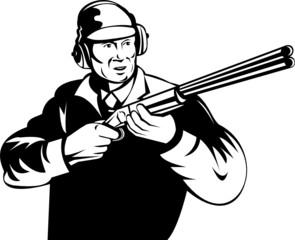 Hunter aiming a shotgun