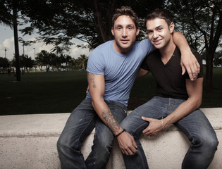 Two handsome young gay men in the park