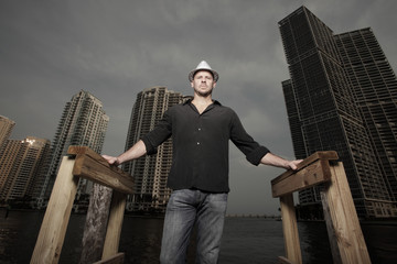 Man standing with buildings in the background