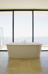 Modern bathroom with bathtub and large windows