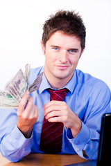 Businessman holding money in office