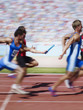 Racers running on track with relay baton