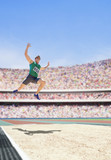 Athlete doing a long jump in an arena