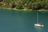 Yacht cruising on Krka river, Dalmatian coast, Croatia poster