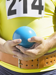 Athlete holding shot-put ball