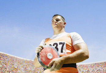 Athlete with discus in arena