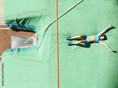 Athlete on a crash mat after pole vault