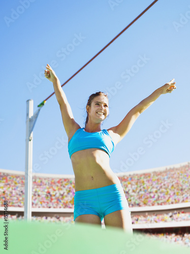 Athlete after pole vault in an arena