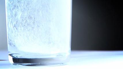 Fizzing Alkaseltzer in Glass of Water