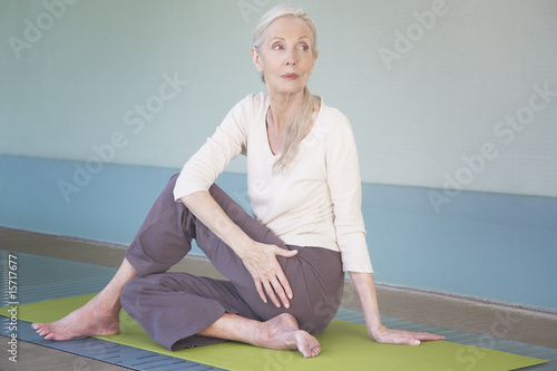 Woman doing yoga indoors on a yoga mat
