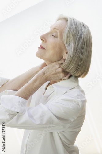 Woman relaxing with her hands on the back of her neck