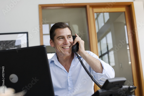Businessman on telephone in office