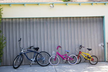 Bikes in front of a closed garage door