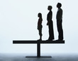 Couple and young girl standing in a line on a plank