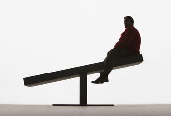 Large man on unbalanced plank