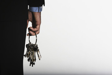 Hand holding large ring of keys