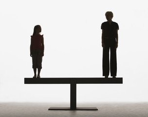 Girl and woman standing on a plank