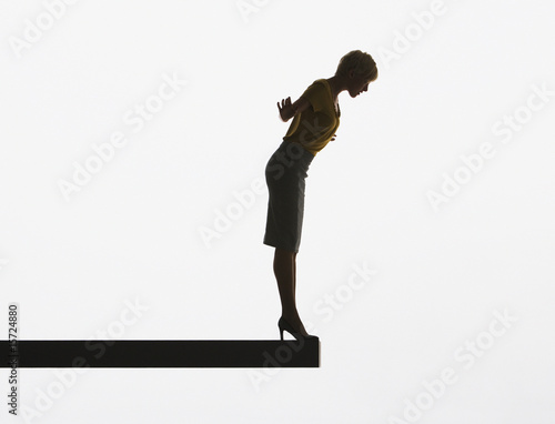 Woman looking over edge of plank