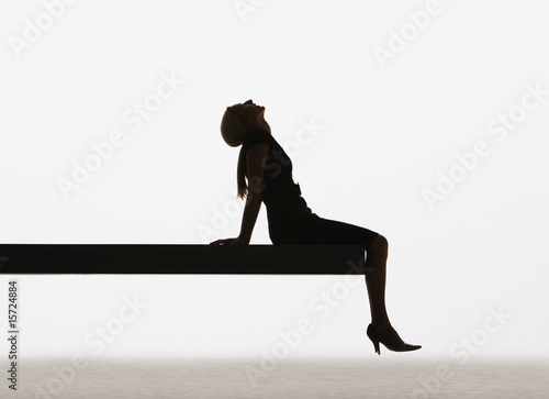 Woman sitting on edge of plank relaxing