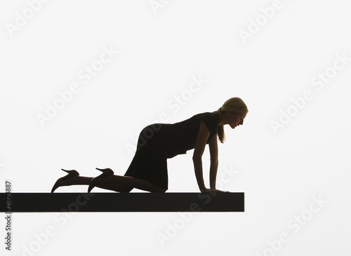 Woman peeking over edge of plank