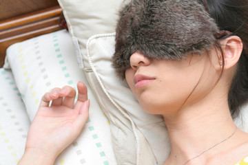 Young lady sound asleep with night eyeshades on