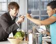 Woman feeding man with a spoon
