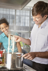 Couple cooking meal in kitchen