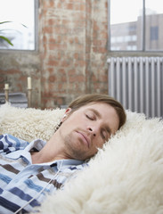 Man sleeping in modern living room