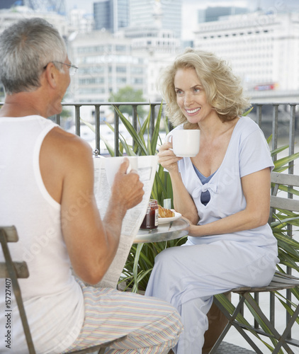 Couple enjoying breakfast on a balcony