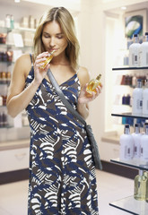 Woman testing perfumes in a store