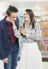 Couple in a store testing perfume