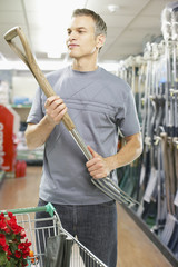 Man looking at pitchfork in store