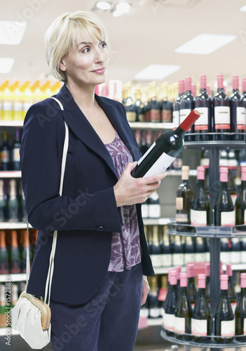 Woman shopping for wine