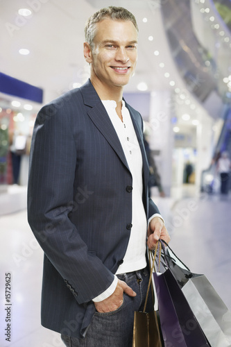 Man with shopping bags in mall