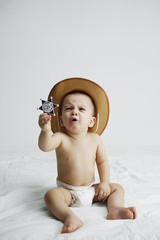 Baby in sheriff outfit