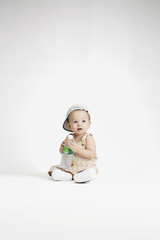 Baby holding bottle of water