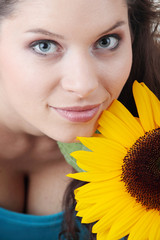 Portrait of a Beautiful girl with sunflower