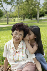 Woman with young girl in park