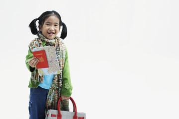 Girl holding large handbag and maps
